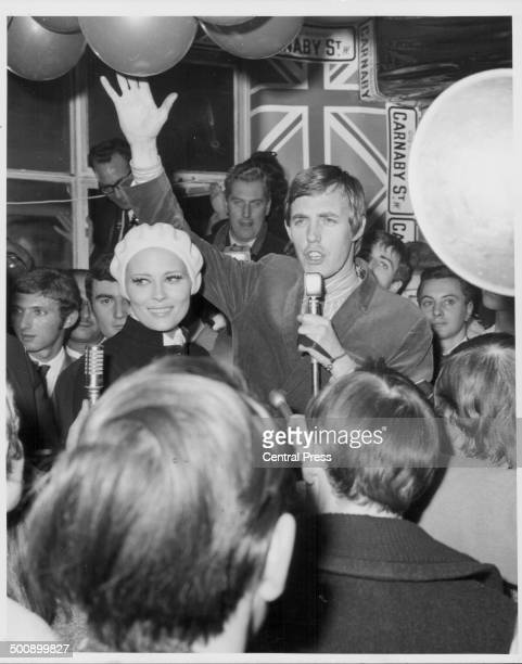 Actress Faye Dunaway turning on the Christmas lights in Carnaby Street, watched by crowds of people, London, November 17th 1967. She is being...