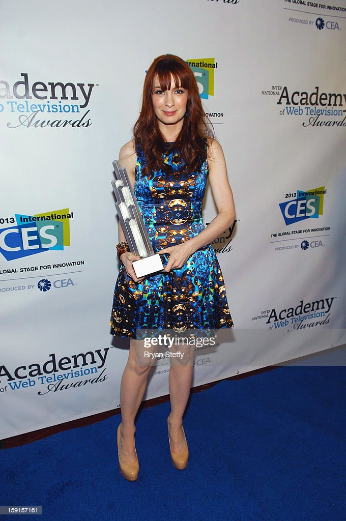 Actress Felicia Day poses with the IAWTV award for 'The Flog' Best Non Fiction Writing Award at the IAWTV Awards at the CES 2013 Show at the Palazzo Theater at the Palazzo Resort Hotel/Casino on January 8, 2013 in Las Vegas, Nevada.