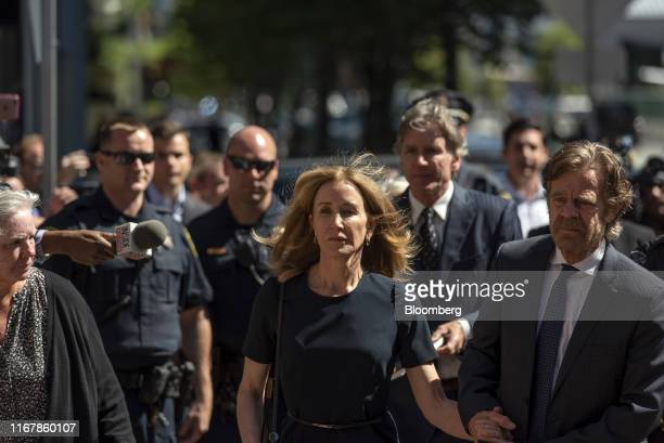 Actress Felicity Huffman, center, arrives at federal court with her husband actor William H. Macy in Boston, Massachusetts, U.S., on Friday, Sept....