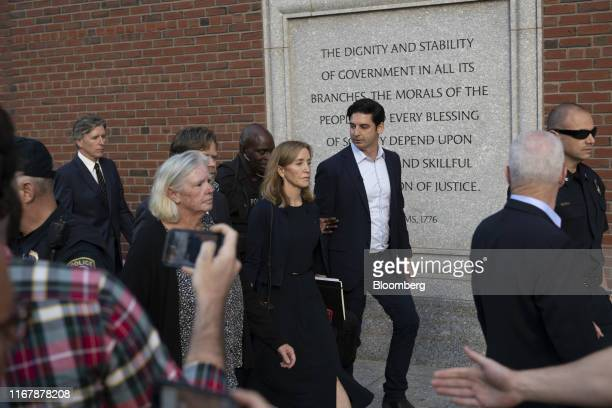 Actress Felicity Huffman, center, departs from federal court in Boston, Massachusetts, U.S., on Friday, Sept. 13, 2019. Huffmangot two weeks in...