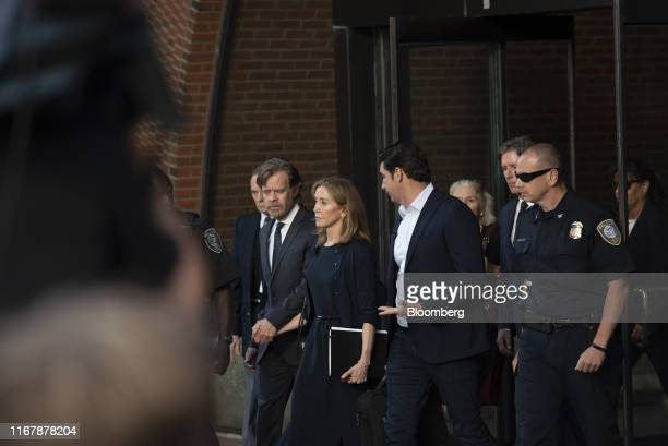 Actress Felicity Huffman, center, departs from federal court with her husband actor William H. Macy, left, in Boston, Massachusetts, U.S., on Friday,...