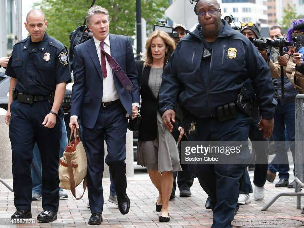 Actress Felicity Huffman center enters the John Joseph Moakley United States Courthouse with her brother Moore Huffman Jr second from left in Boston...