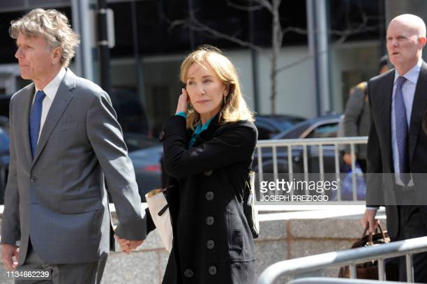 Actress Felicity Huffman enters the court to appear before Judge M Page Kelley to face charge for allegedly conspiring to commit mail fraud and other...