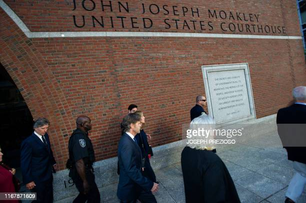 Actress Felicity Huffman escorted by her husband William H Macy and followed by her brother Moore Huffman Jr exits the John Joseph Moakley United...