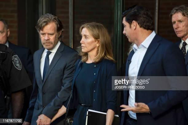 Actress Felicity Huffman escorted by her husband William H Macy and her brother Moore Huffman Jr exits the John Joseph Moakley United States...