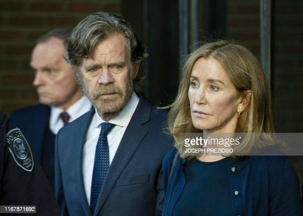 Actress Felicity Huffman, escorted by her husband William H. Macy, exits the John Joseph Moakley United States Courthouse in Boston, where she was...
