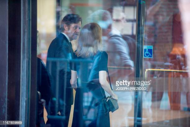 Actress Felicity Huffman, escorted by her husband William H. Macy, makes her way into the John Joseph Moakley United States Courthouse September 13,...