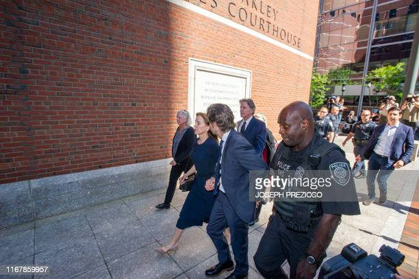 Actress Felicity Huffman, escorted by her husband William H. Macy, makes her way to the entrance of the John Joseph Moakley United States Courthouse...