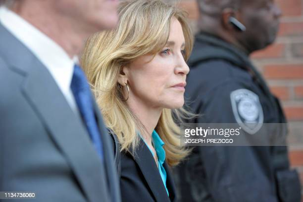 TOPSHOT Actress Felicity Huffman exits the courthouse after facing charges for allegedly conspiring to commit mail fraud and other charges in the...