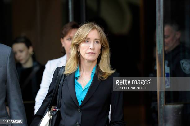 Actress Felicity Huffman exits the courthouse after facing charges for allegedly conspiring to commit mail fraud and other charges in the college...