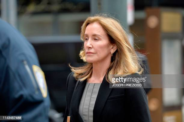 Actress Felicity Huffman is escorted by Police into court where she is expected to plead guilty to one count of conspiracy to commit mail fraud and...