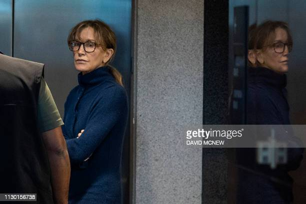 TOPSHOT Actress Felicity Huffman is seen inside the Edward R Roybal Federal Building and US Courthouse in Los Angeles on March 12 2019 Two Hollywood...