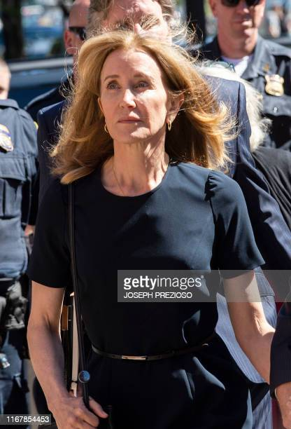Actress Felicity Huffman makes her way to the entrance of the John Joseph Moakley United States Courthouse September 13, 2019 in Boston, where she...