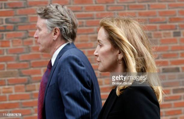 Actress Felicity Huffman right enters the John Joseph Moakley United States Courthouse with her brother Moore Huffman Jr left in Boston on May 13...