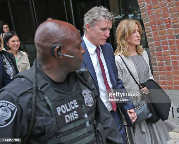 Actress Felicity Huffman right leaves the John Joseph Moakley United States Courthouse with her brother Moore Huffman Jr center in Boston on May 13...