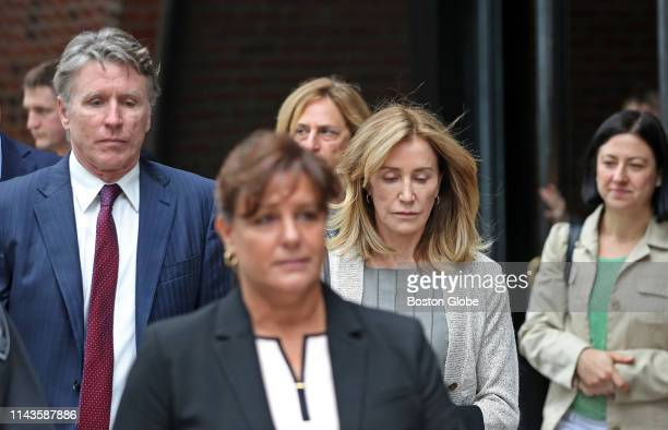 Actress Felicity Huffman right leaves the John Joseph Moakley United States Courthouse with her brother Moore Huffman Jr left in Boston on May 13...