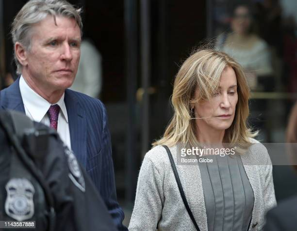 Actress Felicity Huffman, right, leaves the John Joseph Moakley United States Courthouse with her brother Moore Huffman Jr., left, in Boston on May...