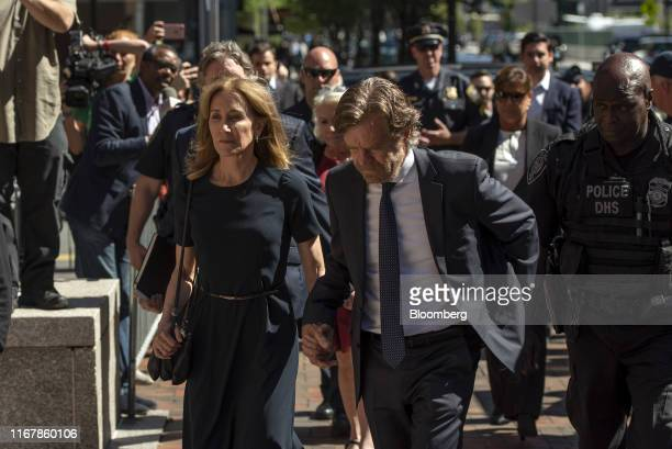 Actress Felicity Huffman, second left, arrives at federal court with her husband actor William H. Macy in Boston, Massachusetts, U.S., on Friday,...