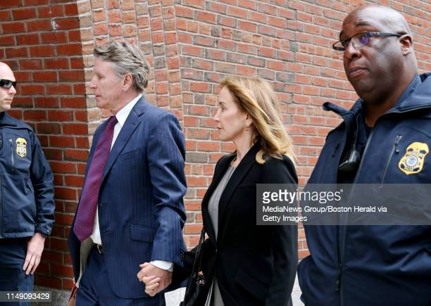 """Actress Felicity Huffman walks into the Moakley Federal Courthouse where she is expected to plead guilty to charges related to the """"Operation Varsity..."""