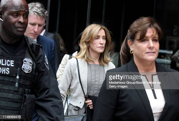 Actress Felicity Huffman walks out of Boston Federal Court after the hearing, Monday, May 13 in Boston. Jim Michaud / MediaNews Group/Boston Herald)