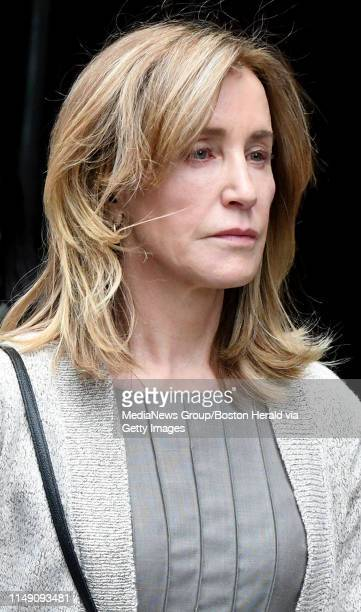 Actress Felicity Huffman walks out of Boston Federal Court after the hearing, Monday, May 13 in Boston. Jim Michaud / MediaNews Group/Boston Herald...