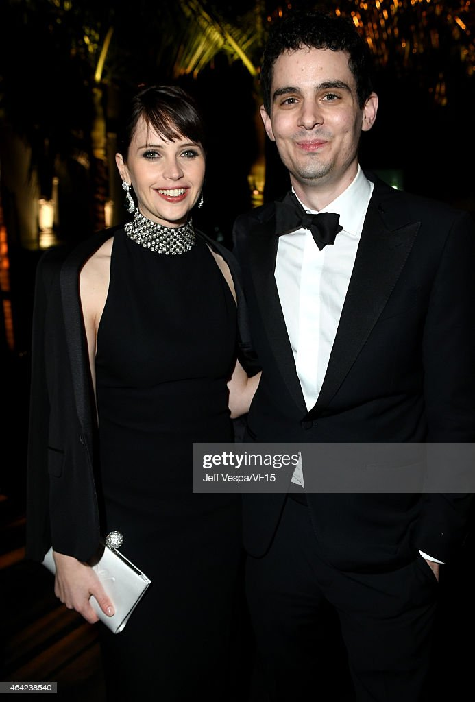 Actress Felicity Jones (L) and director Damien Chazelle attend the 2015 Vanity Fair Oscar Party hosted by Graydon Carter at the Wallis Annenberg Center for the Performing Arts on February 22, 2015 in Beverly Hills, California.