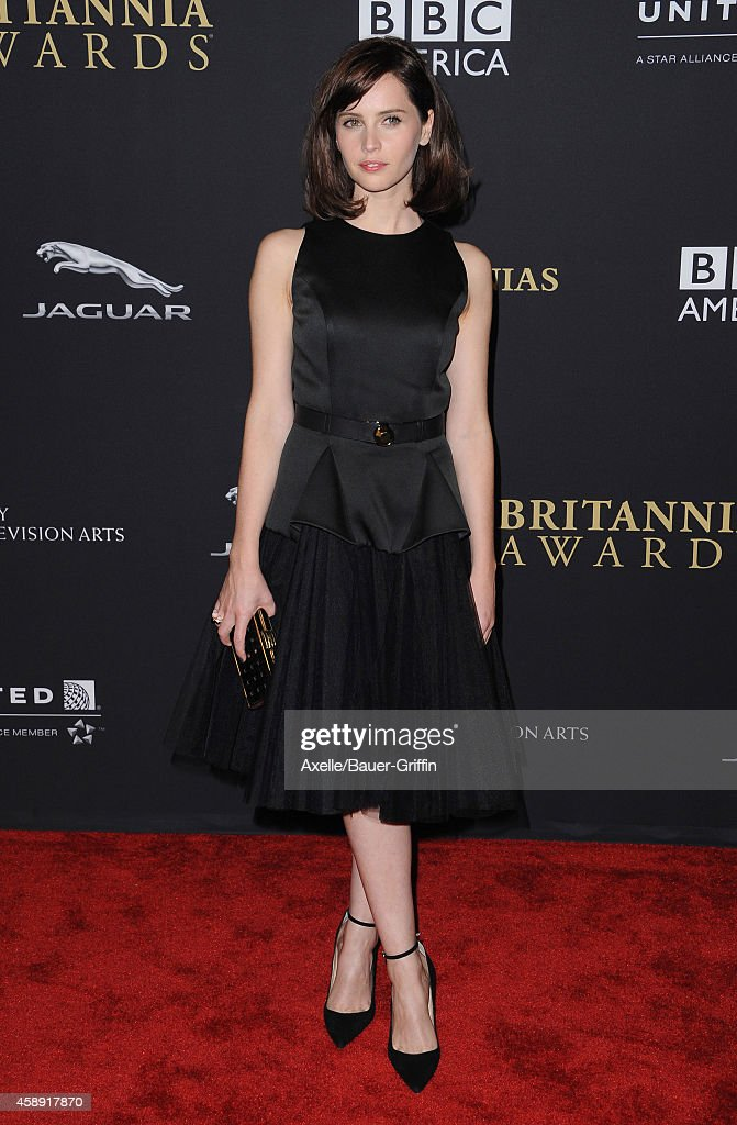 Actress Felicity Jones arrives at the BAFTA Los Angeles Jaguar Britannia Awards at The Beverly Hilton Hotel on October 30, 2014 in Beverly Hills, California.