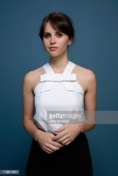 Actress Felicity Jones of 'The Invisible Woman' poses at the Guess Portrait Studio during 2013 Toronto International Film Festival on September 7...