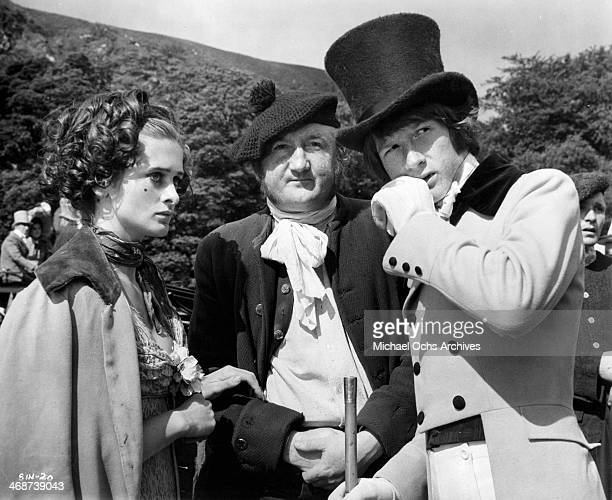 Actress Fidelma Murphy actors Ronald Fraser and John Hurt on set the movie 'Sinful Davey' circa 1969