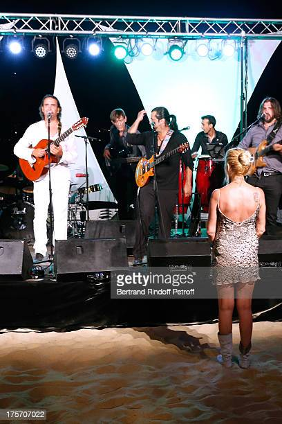 Actress Fiona Gelin dances as singer Sebastien El Chato performs at President of the Union of Showmen Marcel Campion's Party at 'La Bouillabaisse'...