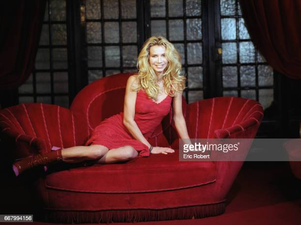 Actress Fiona Gelin on Red Loveseat