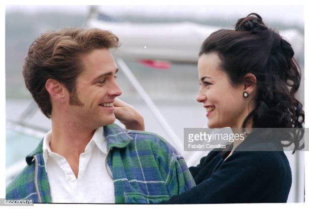 Actress Fiona Loewi puts her hand in actor Jason Priestley's hair as they both smile on the set of the movie Love and Death on Long Island directed...
