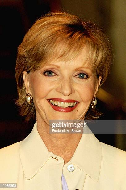 Actress Florence Henderson models an outfit during the 33rd Annual Celebrity Fashion Show and Auction October 3 2001 in Beverly Hills CA The event...
