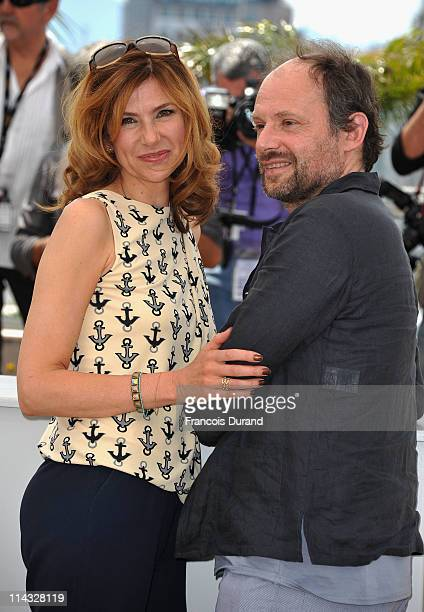 Actress Florence Pernel and actor Denis Podalydes attend the La Conquete photocall at the Palais des Festivals during the 64th Cannes Film Festival...