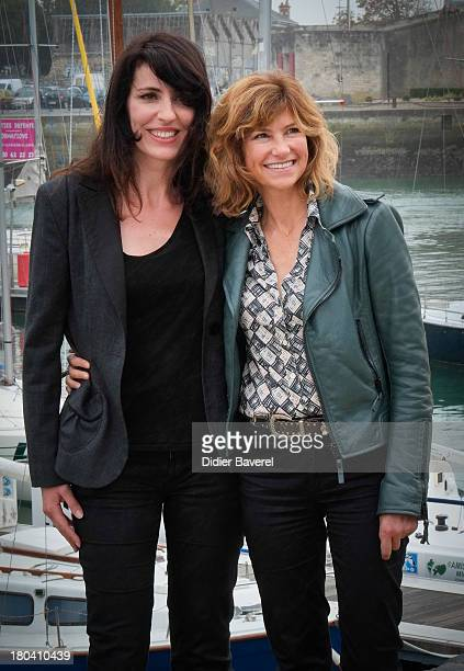 Actress Florence Pernel and musician La Grande Sophie pose during the photocall of 'Nom de Code Rose' at the 15th Festival of the TV Fiction on...