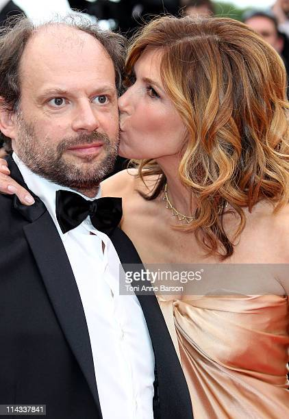 Actress Florence Pernel kisses actor Denis Podalydes as they attend the La Conquete Premiere during the 64th Annual Cannes Film Festival at the...