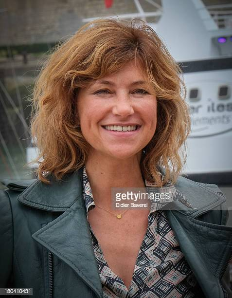 Actress Florence Pernel poses during the photocall of 'Nom de Code Rose' at the 15th Festival of the TV Fiction on September 12 2013 in La Rochelle...