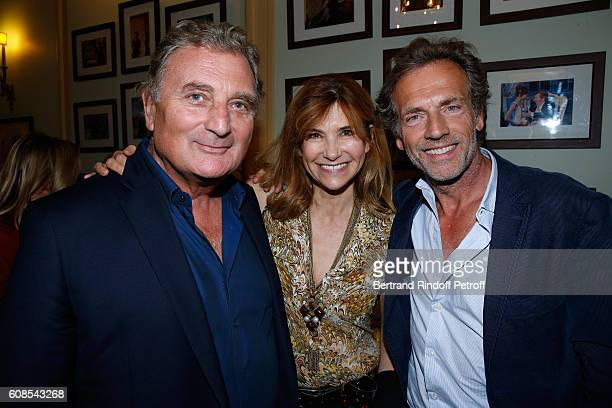 Actress Florence Pernel standing between her husband Patrick Rotman and actor Stephane Freiss attend the Tout ce que vous voulez Theater Play at...