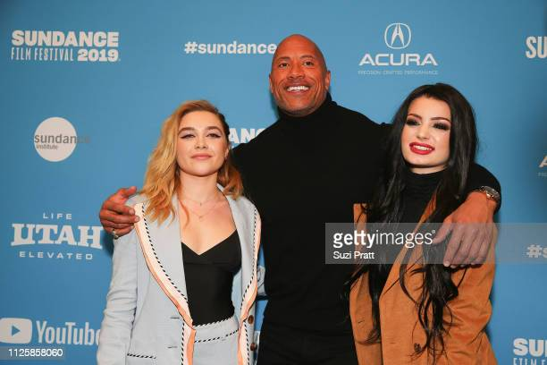 Actress Florence Pugh actor and producer Dwayne Johnson and Paige pose for a photo at a Sundance special screening of Fighting with My Family on...