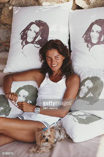 Actress Florinda Balkan in Porto Rotondo Sardinia rests on cushions covered with her likeness