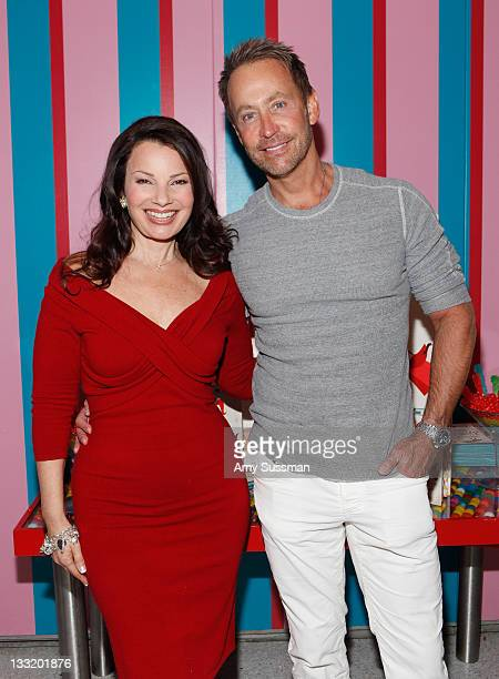 Actress Fran Drescher and Peter Marc Jacobson attend Fran Drescher new picture book celebration of 'Being Wendy' at Dylan's Candy Bar on November 17...