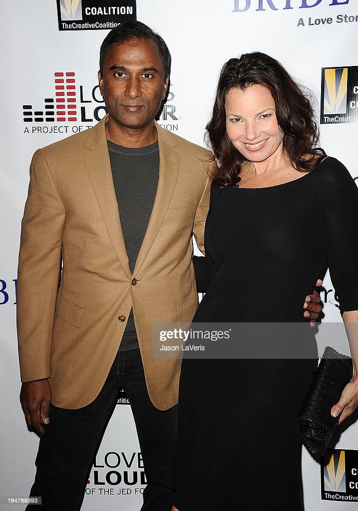 Actress Fran Drescher (R) and Shiva Ayyadurai attend the premiere of 'Bridegroom' at AMPAS Samuel Goldwyn Theater on October 15, 2013 in Beverly Hills, California.