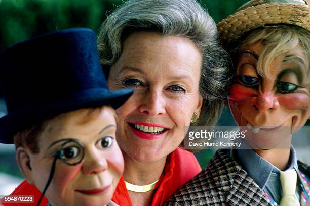 Actress Frances Bergen whose late husband was the ventriloquist Edgar Bergen poses with his characters Charlie McCarthy and Mortimer Snerd March 1980
