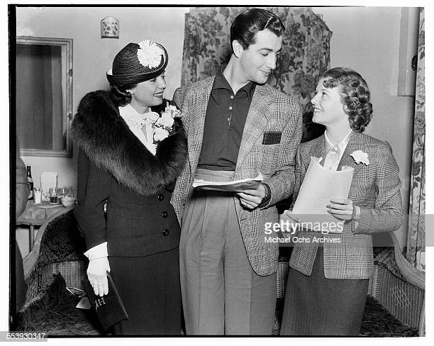 Actress Frances Langford with actor Robert Taylor talk with actress Janet Gaynor in Los Angeles California