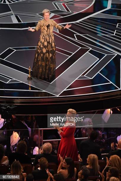 TOPSHOT US actress Frances McDormand calls for women nominees to stand up as she delivers a speech after she won the Oscar for Best Actress in 'Three...
