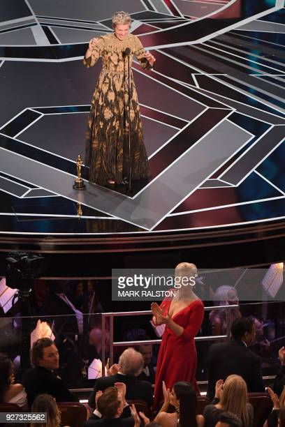 US actress Frances McDormand calls for women nominees to stand up as she delivers a speech after she won the Oscar for Best Actress in 'Three...