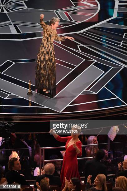 TOPSHOT US actress Frances McDormand calls for women nominees to stand up as she delivers a speech after she won the Oscar for Best Actress in Three...