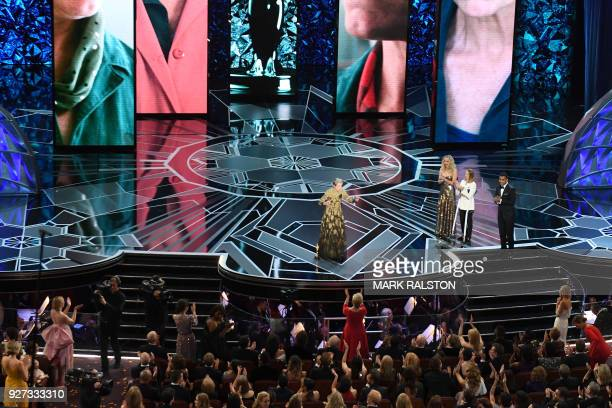 US actress Frances McDormand delivers a speech next to US actresses Jodie Foster and Jennifer Lawrence after she won the Oscar for Best Actress in...