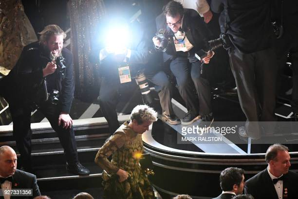 US actress Frances McDormand leaves the stage after she won the Oscar for Best Actress in Three Billboards outside Ebbing Missouri during the 90th...