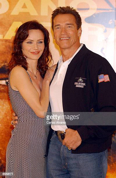 Actress Francesca Neri and actor Arnold Schwarzenegger attend a promotion of their new movie 'Collateral Damage' February 8 2002 at the Hotel...